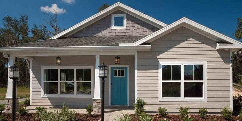 Front Florida Home Elevation with Stunning Blue Door