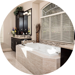 Sustainability Bathroom Remodeling Trend Glass Shower Half-Wall Freestanding Tub Black Fixtures