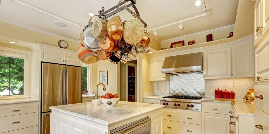 Hanging pot rack in outdated kitchen