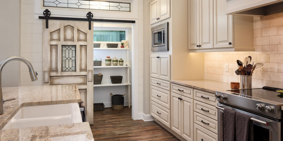 Kitchen with pantry with a sliding barn door in Gainesville