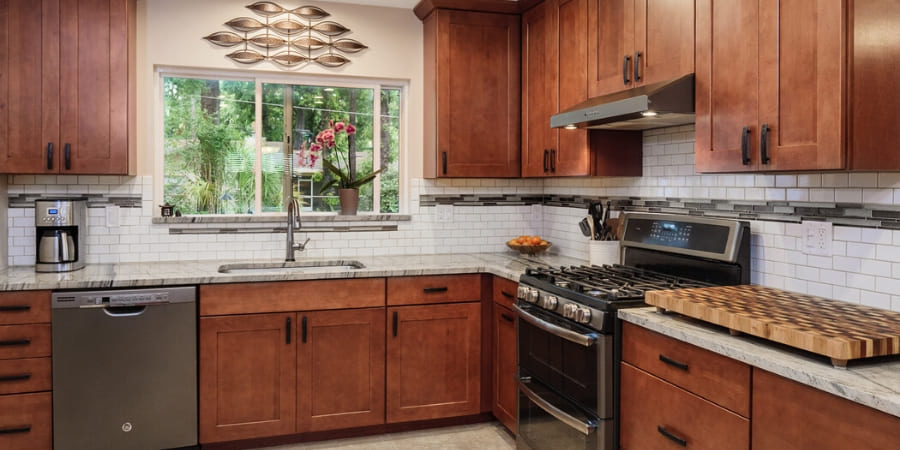 Kitchen with wood grain cabinetry in Gainesville