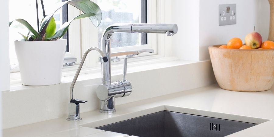 chrome statement kitchen faucet and sink