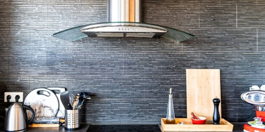 extended kitchen backsplash with stainless steel and glass modern oven range hood