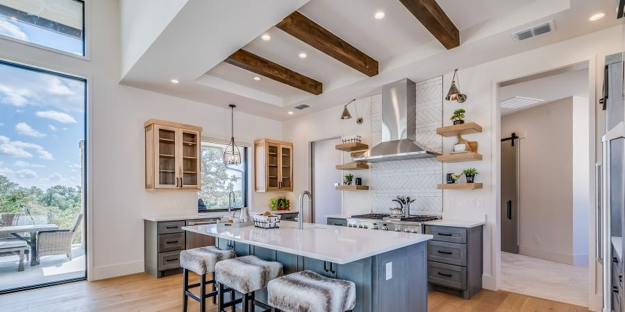 intricate exposed beam ceiling with recessed lighting