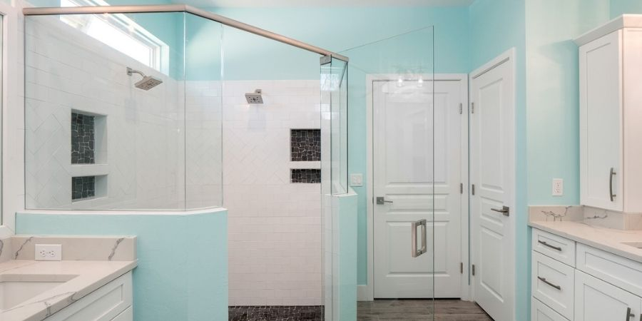 light blue and white bathroom with storage niches